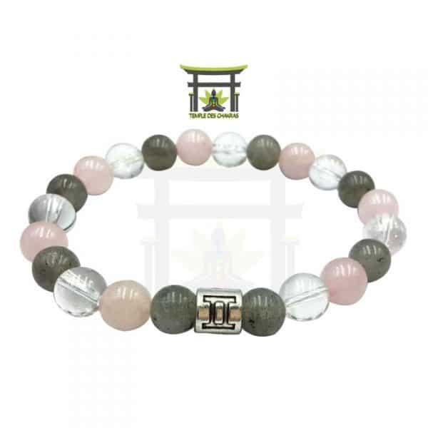 Bracelet Astro Gémeaux en Labradorite, Quartz Rose et Cristal de Roche sur plancher en bois et fond astrale